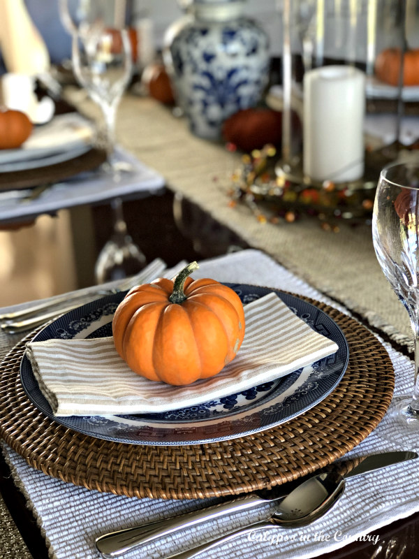 Fall place setting with orange pumpkin - embracing fall in the dining room
