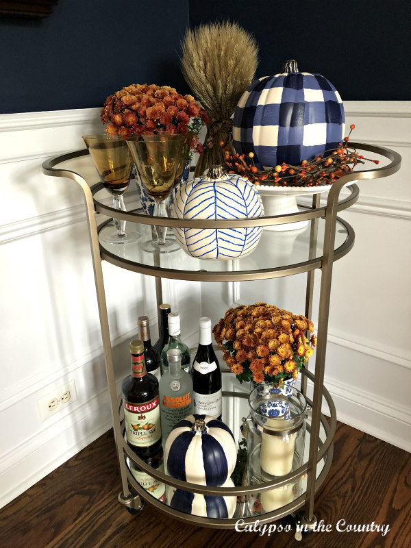 Fall bar cart with painted pumpkins and mums