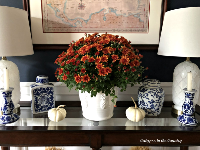 Orange mums on table - Embracing Fall in the Dining Room