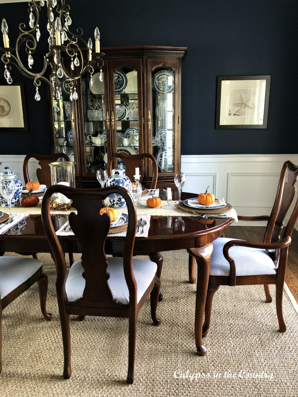 Navy Dining Room decorated for fall with orange pumpkins