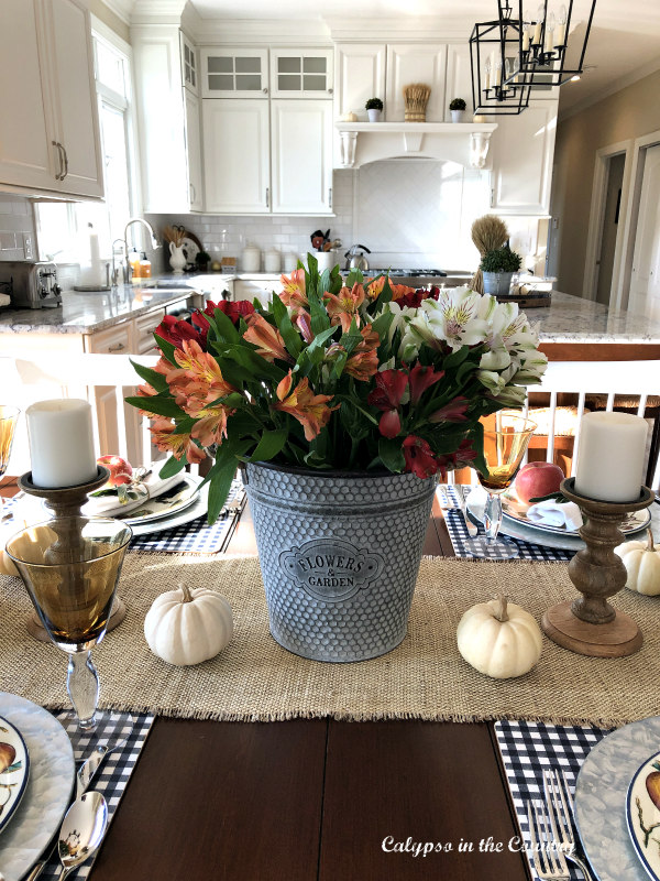 Colorful flowers in galvanized bucket for a casual Thanksgiving table setting