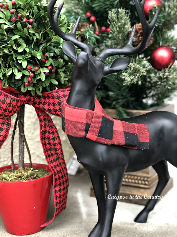 Simple Christmas porch with black deer