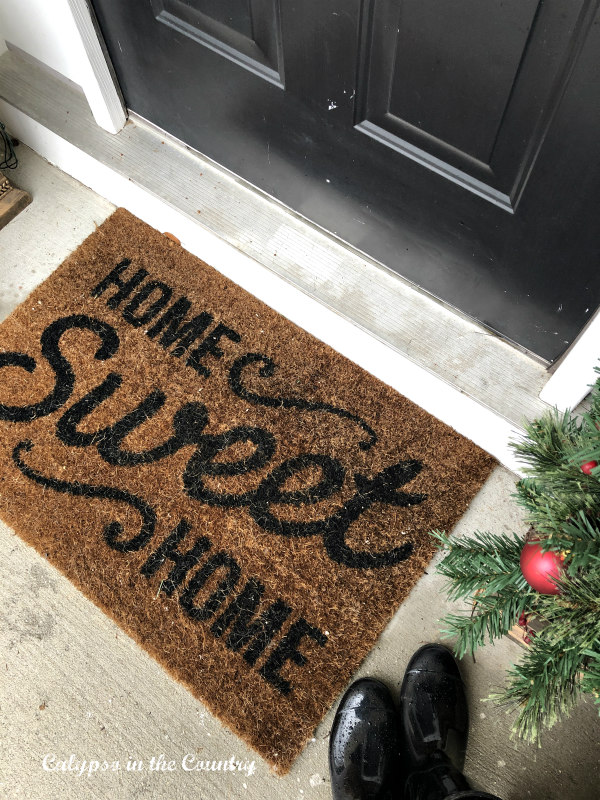 holiday porch with welcome mat