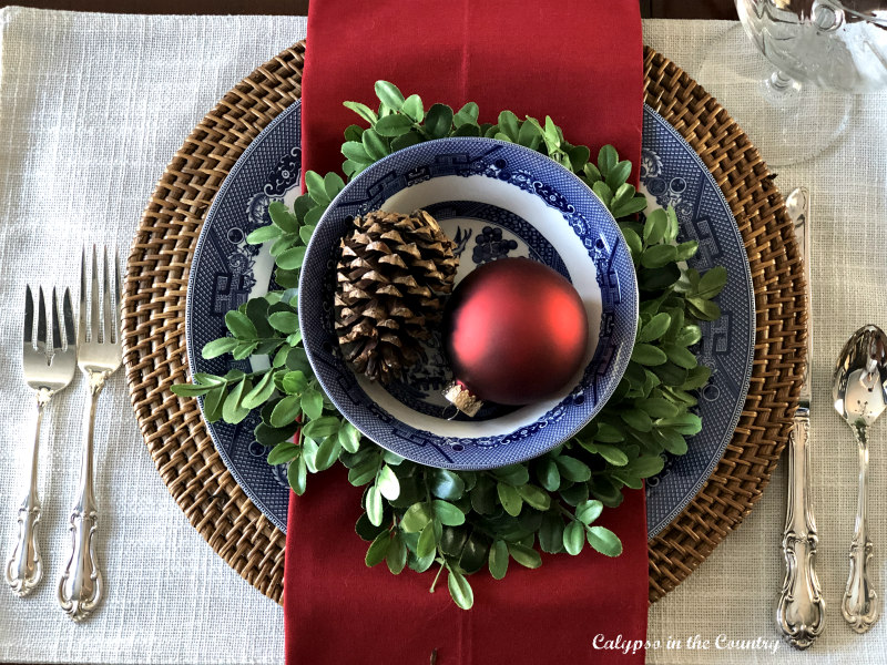 Festive Place Setting on Christmas Table in Dining Room