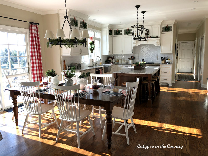 White kitchen decorated for Christmas - farmhouse style