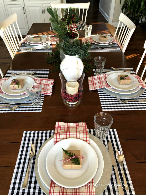 farmhouse christmas table with red and black