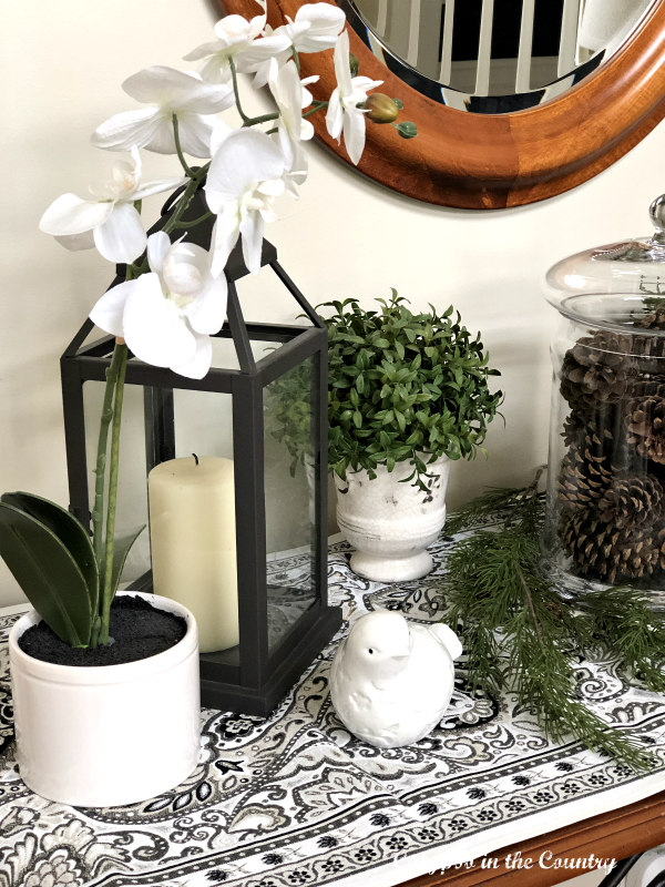 greenery with black and white accessories for January decor