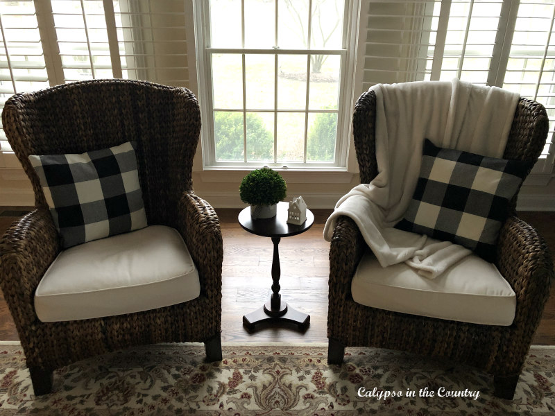seagrass chairs with black and white pillows