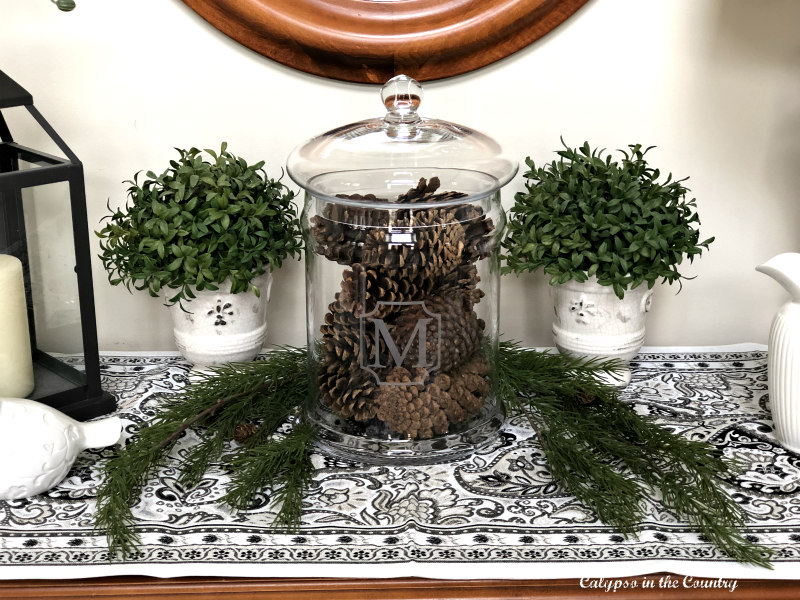 Pine cones and greenery on foyer table
