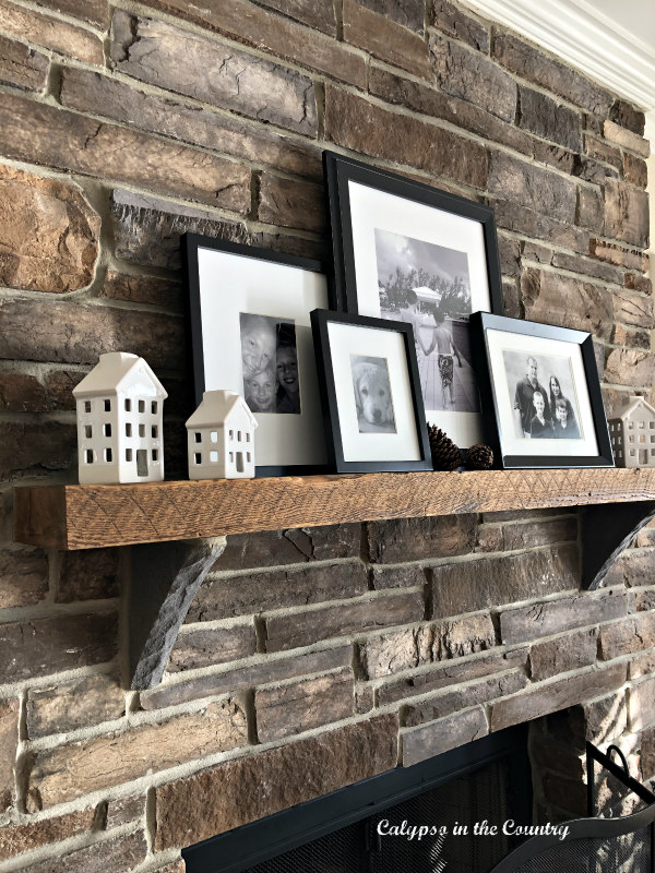 stone fireplace with black and white photos