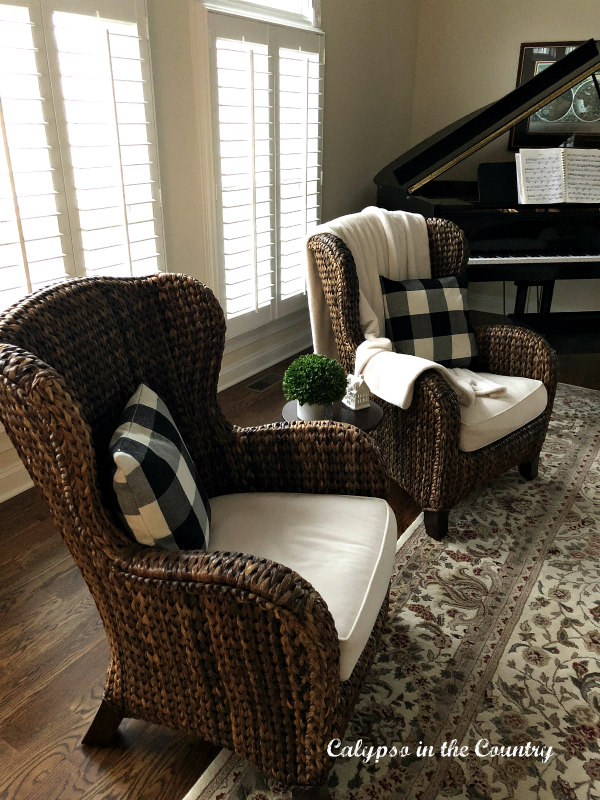 seagrass chairs with black and white buffalo check pillows