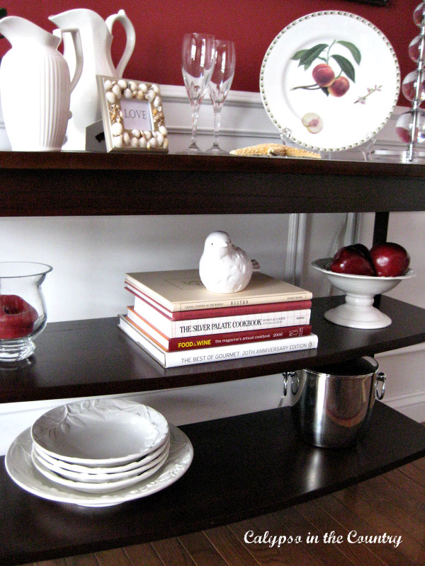 shelves in red dining room decorated for Valentine's Day
