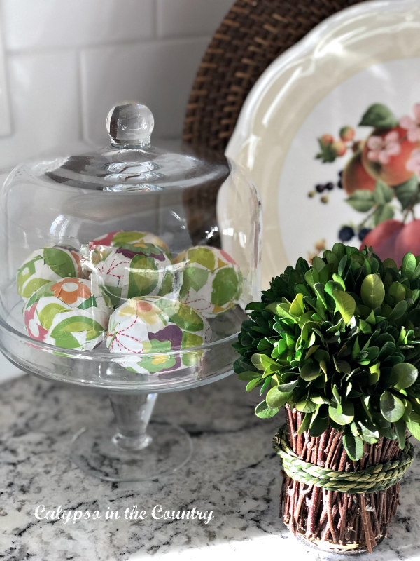 Corner vignette with glass cloche