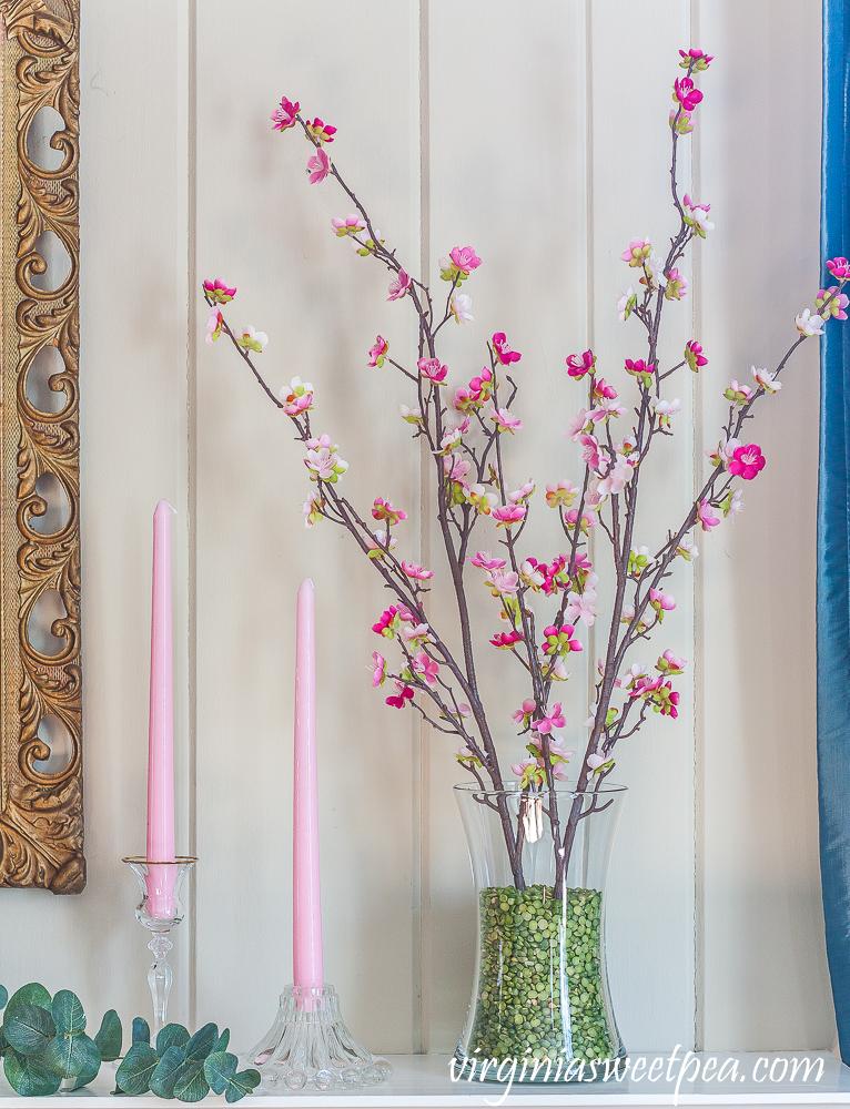 Pink flowers on mantel