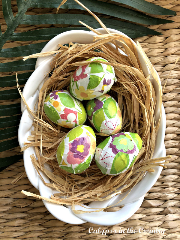 basket of decoupaged Easter Eggs