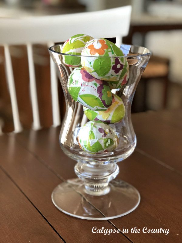 Easter eggs in glass container