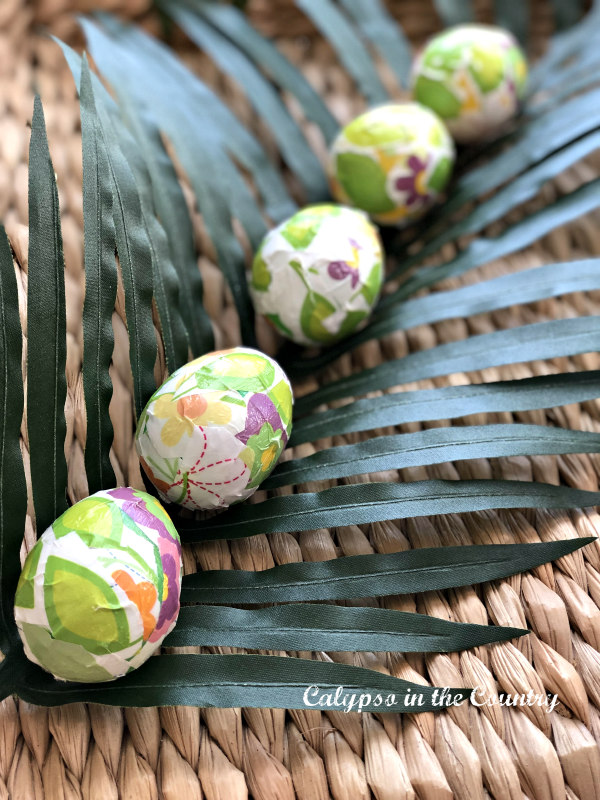 Easter eggs on palm leaves