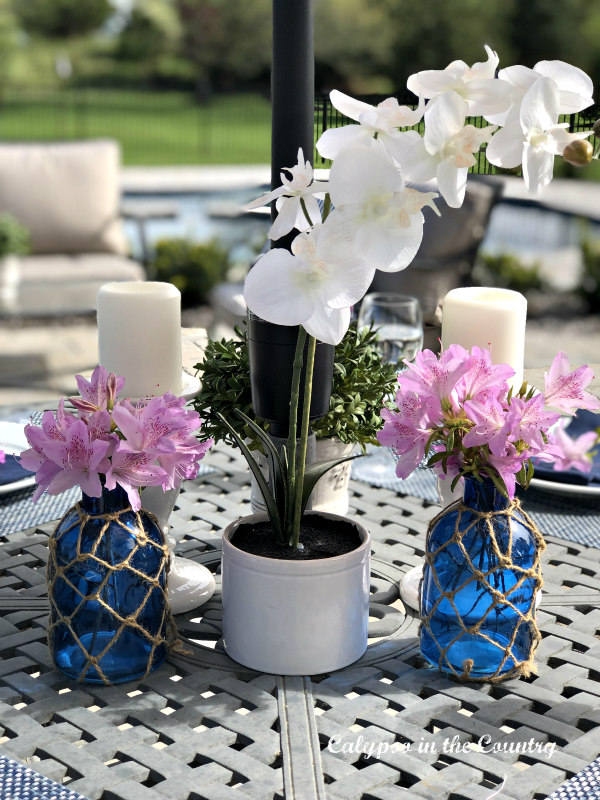 Orchids and flowers from the garden - outdoor centerpiece - Simple Ideas for Outdoor Spaces