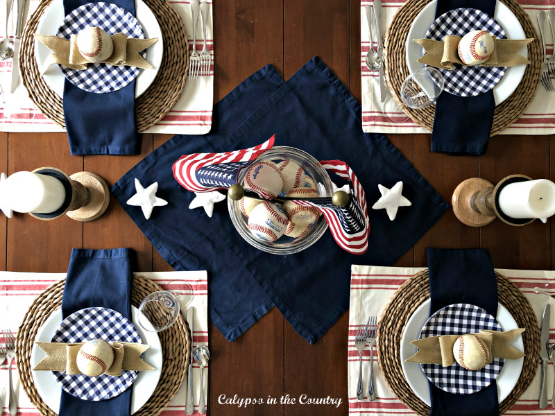 Patriotic Tablescape with Old Baseballs - how to decorate a sophisticated baseball themed table...great for birthdays or Father's Day! #patriotictable #baseballthemedtable