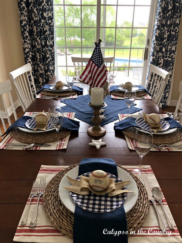 Red white and blue tablescape with blue and white curtains - ideas for patriotic decorating