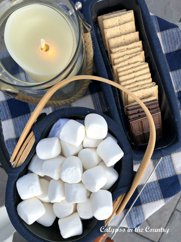 basket of marshmallows graham crackers and chocolate for smores outdoor entertaining