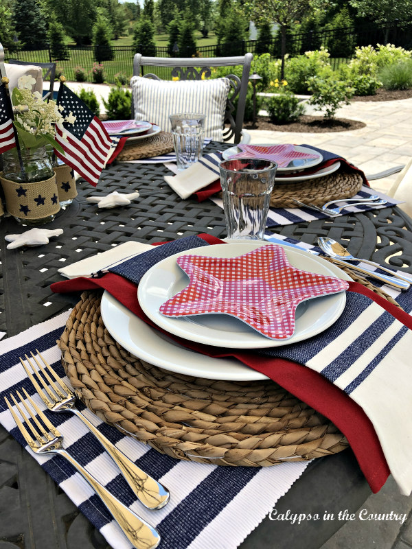 Red white and blue flag themed patriotic tablescape on the patio