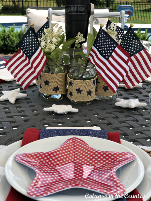 Flags and stars on outdoor patio table - patriotic ideas for the 4th of July