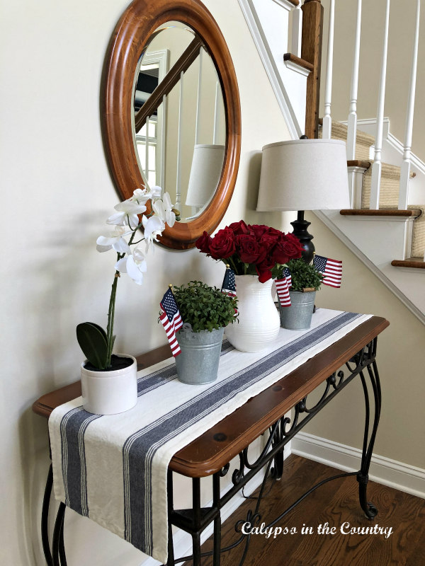 Foyer table decorated in red, white and blue