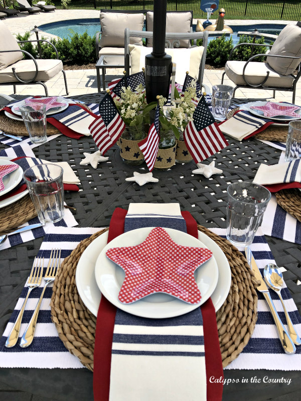 Stars and stripes patriotic tablescape on the patio