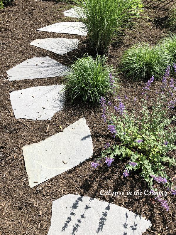 Stone garden path in backyard garden - simple pleasures in life