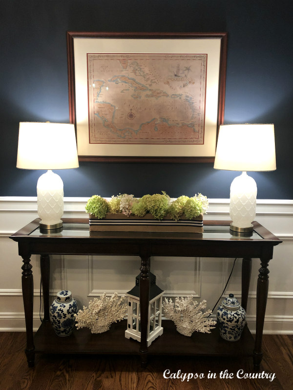 DIY Flowerbox with hydrangeas in navy dining room.