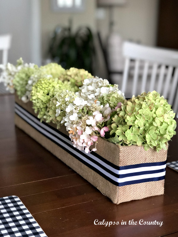 DIY Flower Box Centerpiece made from a cardboard box and burlap