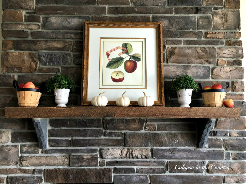 Rustic Fireplace with Apples and Pumpkins decorated for autumn