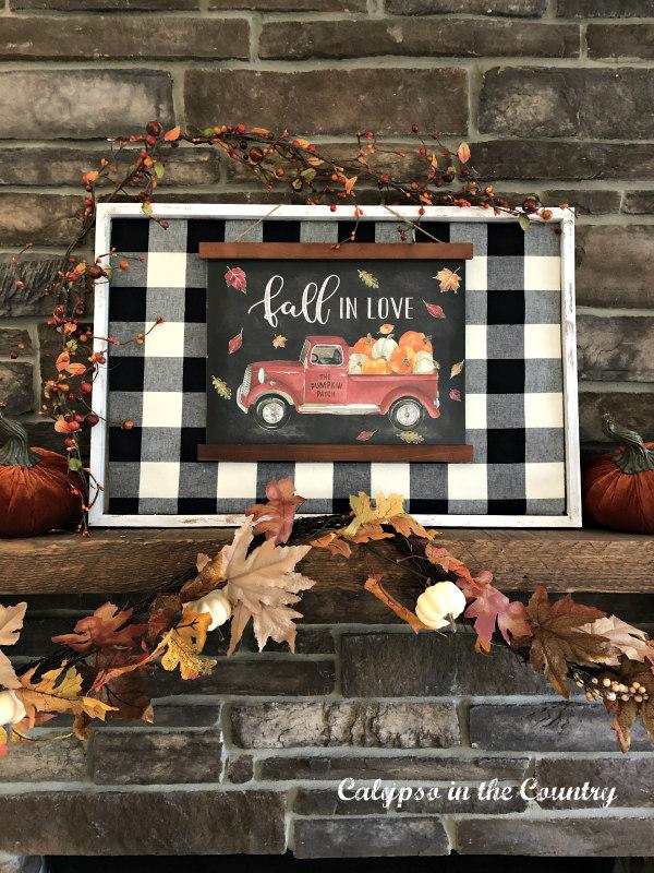 Buffalo Check sign on fall fireplace