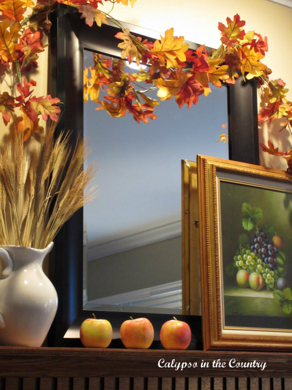 Colorful Fall Mantel with Apples and other ideas for decorating a mantel for fall