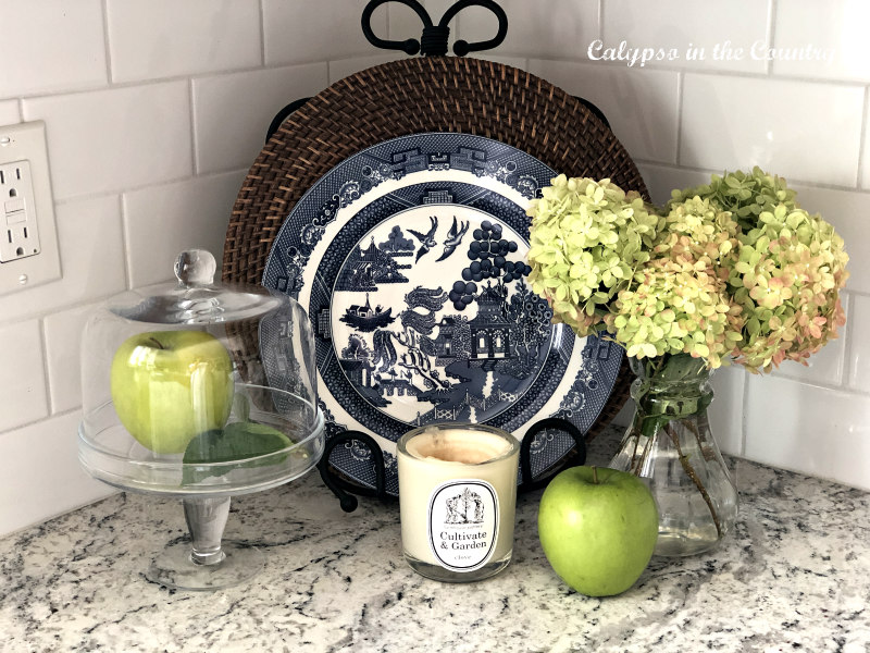 Blue willow plate with green hydrangeas - transitional decorating from summer to fall