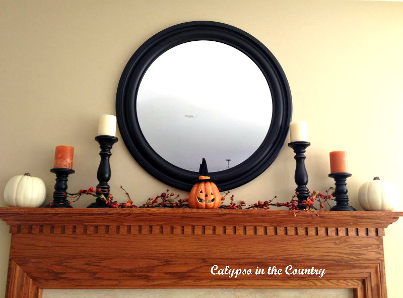 Round Mirror above fall mantel