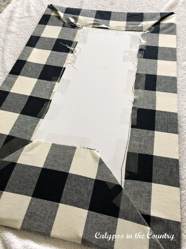 Buffalo check fabric wrapped around foam board