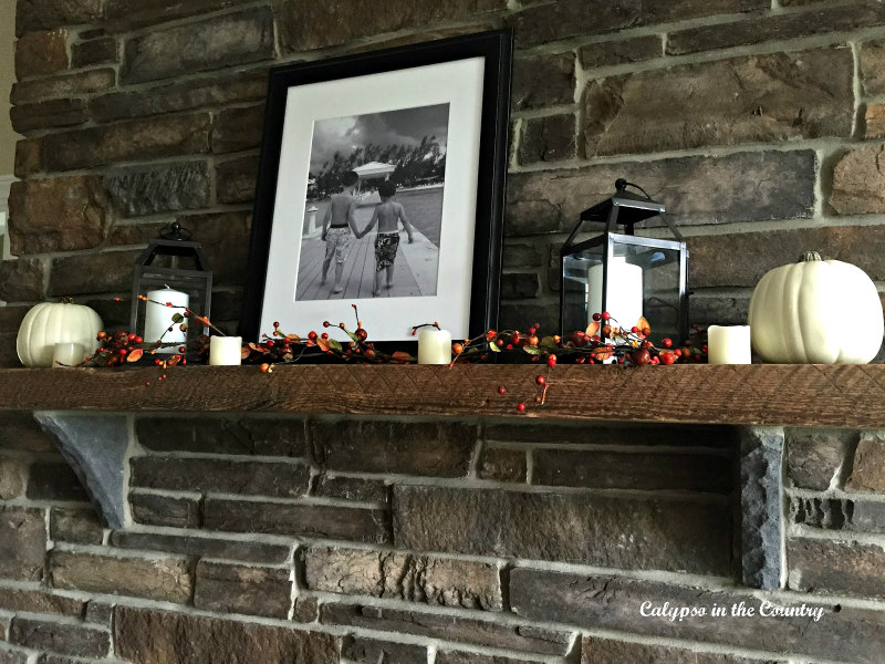 Black and White photo with pumpkins and candles - decorating a simple mantel for fall