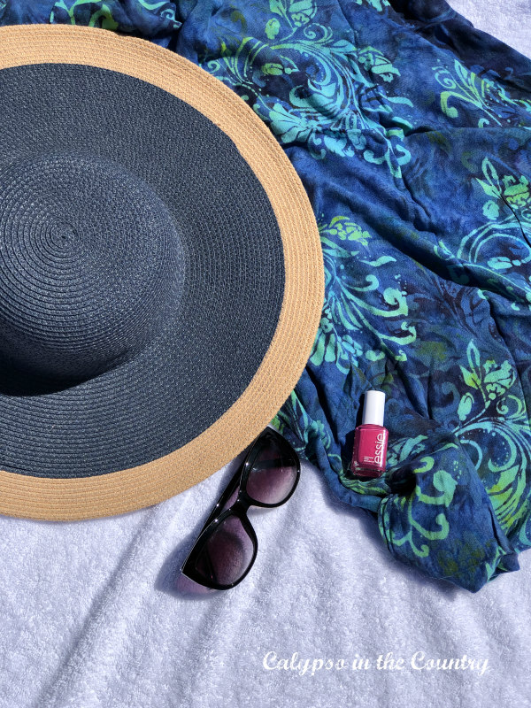 Sun hat and pool essentials for a backyard staycation