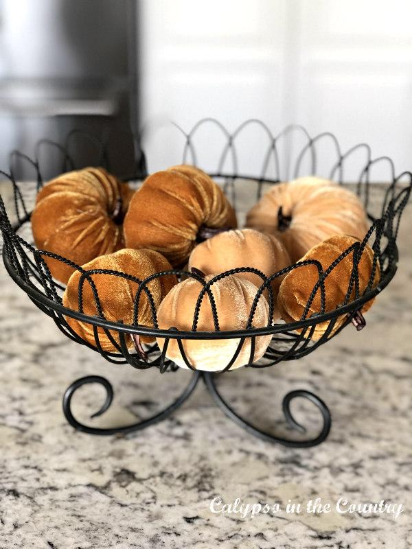 Basket of Mini Velvet pumpkins - affordable fall decor ideas