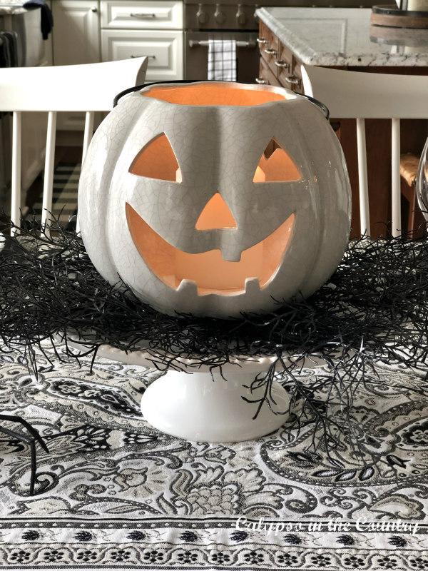 White Jack O' Lantern Centerpiece on Halloween Table
