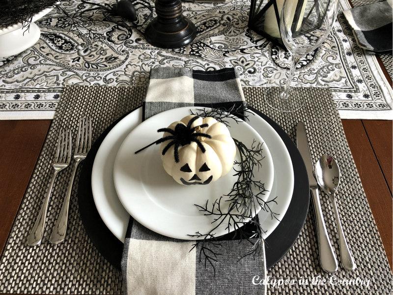 Black and White Place Setting with White Pumpkin Jack o' Lantern