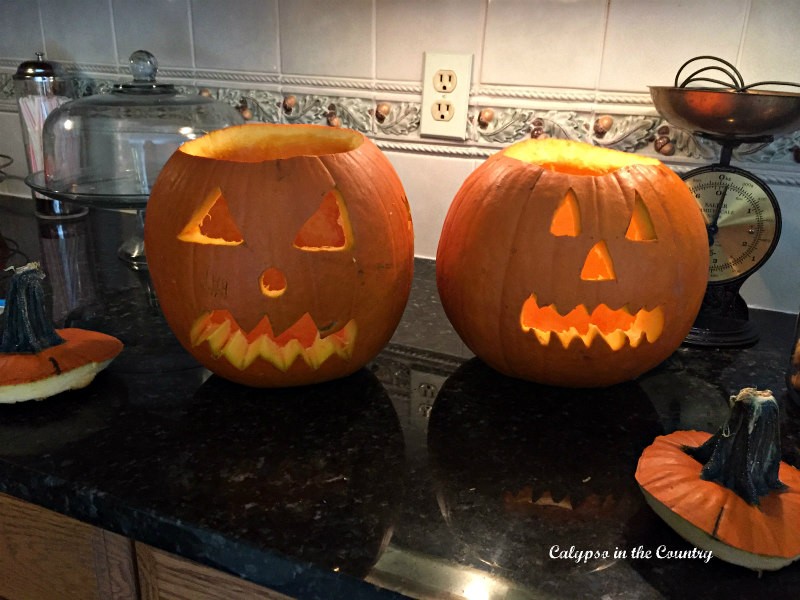 Two Jack-o-lanterns on counter - Halloween Inspiration