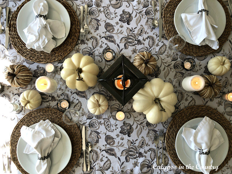 Patterned Fall tablecloth and four place settings