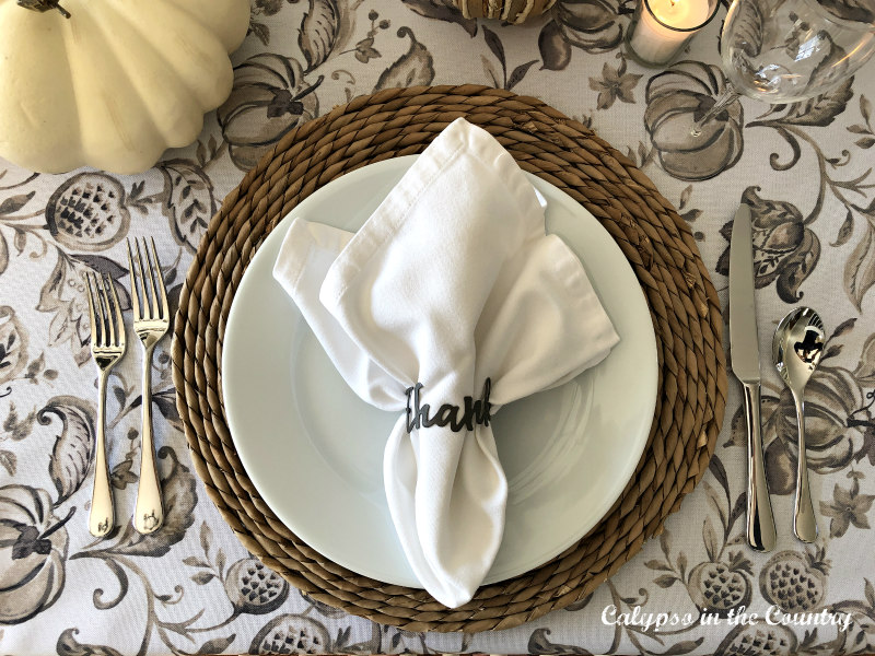 Neutral and Simple Thanksgiving Tablescape with white napkin