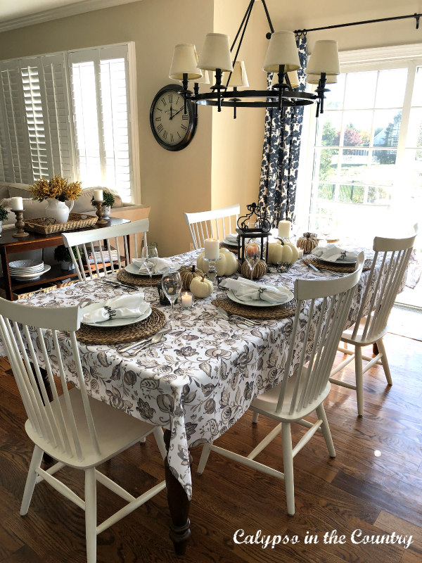 Neutral Tablesetting with white chairs - Simple Thanksgiving Table Decor Ideas
