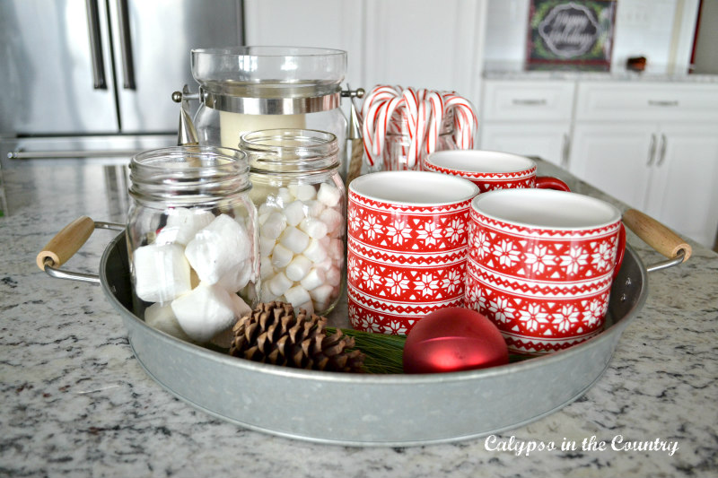 Round galvanized tray with mugs and hot chocolate toppings - Cozy Shopping Finds