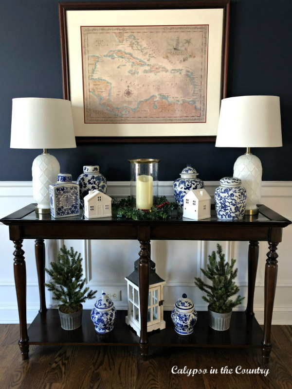 White Ceramic Christmas Houses in Navy Dining Room