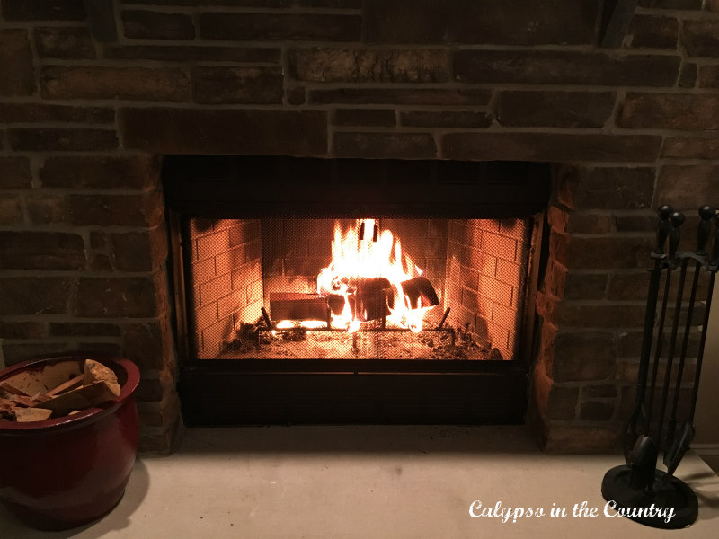 fire in stone fireplace
